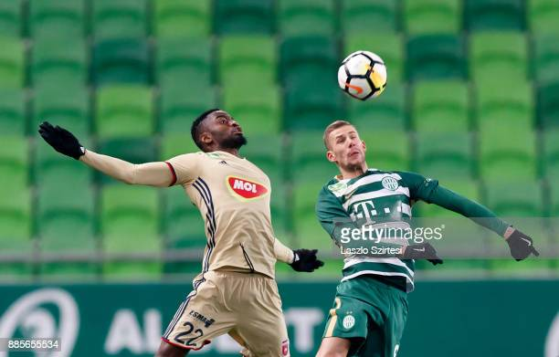 Roland Varga of Ferencvarosi TC battles for the ball in the air with Ianique dos Santos Tavares 'Stopira' #22 of Videoton FC during the Hungarian OTP...