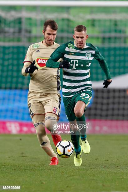 Roland Varga of Ferencvarosi TC competes for the ball with Marko Scepovic of Videoton FC during the Hungarian OTP Bank Liga match between...