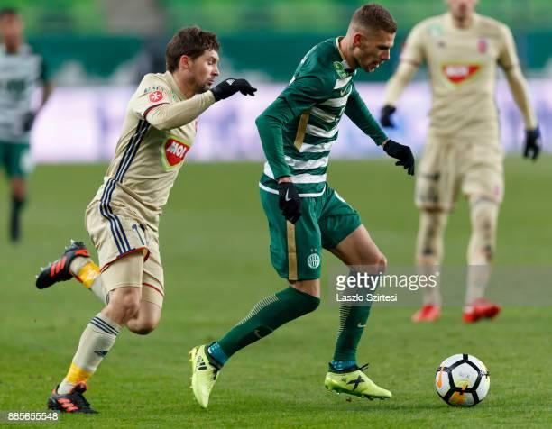 Roland Varga of Ferencvarosi TC leaves Mate Patkai of Videoton FC behind during the Hungarian OTP Bank Liga match between Ferencvarosi TC and...