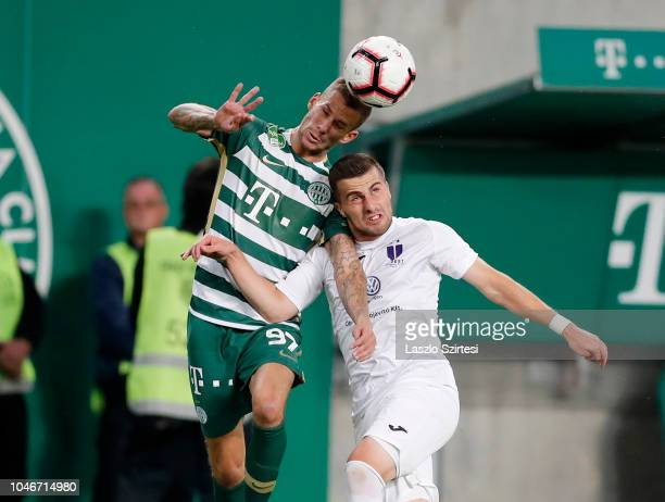 Roland Varga of Ferencvarosi TC wins the ball in the air from Dzenan Burekovic of Ujpest FC during the Hungarian OTP Bank Liga match between...
