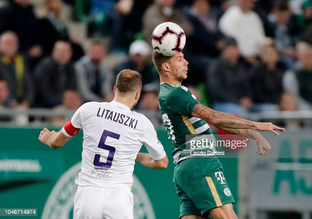 Roland Varga of Ferencvarosi TC wins the ball in the air from Robert Litauszki of Ujpest FC during the Hungarian OTP Bank Liga match between...