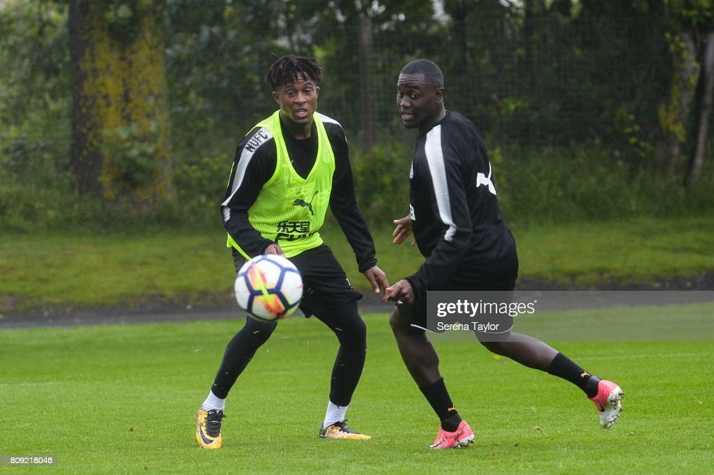 Rolando Aarons (L) and Henri Saivet look at the ball during the Newcastle United Training session at the Newcastle United Training Centre on July 5, 2017, in Newcastle upon Tyne, England.