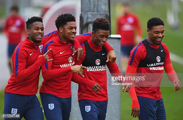 Rolando Aarons Chuba Akpom Demarai Gray and Jordon Ibe joke during an England U21 training session ahead of their UEFA U21 European Championship...