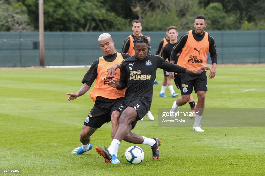 Rolando Aarons (R) controls the ball whilst being challenged by Kenedy (L) during the Newcastle United Training session at Carton House on July 12, 2018, in Kildare, Ireland.