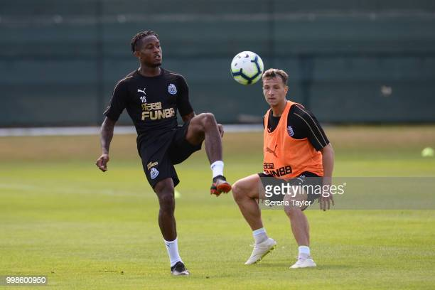 Rolando Aarons controls the ball whilst Jamie Sterry looks to challenge during the Newcastle United Training session at Carton House on July 14 in...