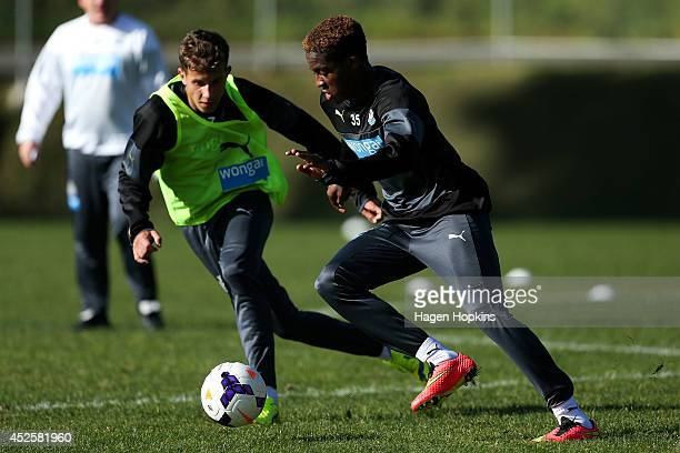 Rolando Aarons looks to get past Lubo Satka during a Newcastle United training session at Newtown Park on July 24 2014 in Wellington New Zealand