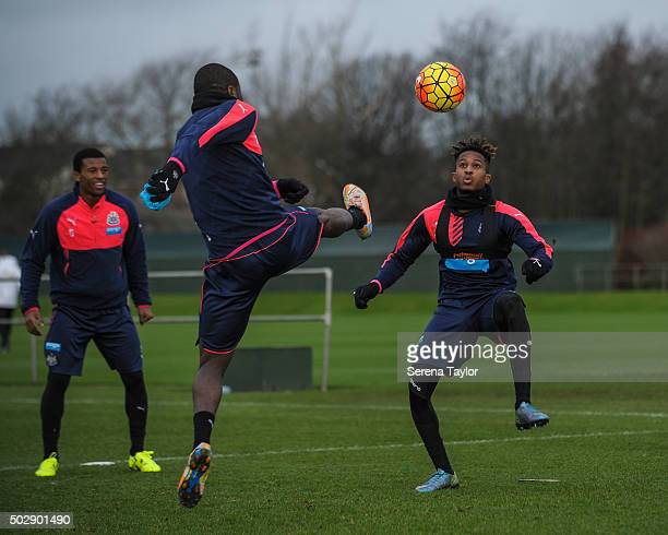 Rolando Aarons looks to receive the ball whilst Chancel Mbemba jumps in the air to intercept the pass during the Newcastle United Training session at...