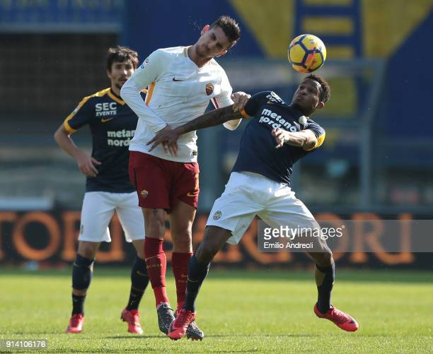 Rolando Aarons of Hellas Verona competes for the ball with Lorenzo Pellegrini of AS Roma during the serie A match between Hellas Verona FC and AS...