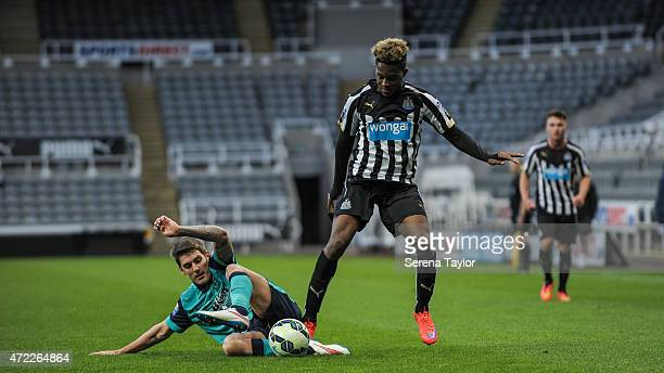 Rolando Aarons of Newcastle is tackled by Blackburn Rovers Connor Mahoney during the Under 21 Premier League match between Newcastle United and...