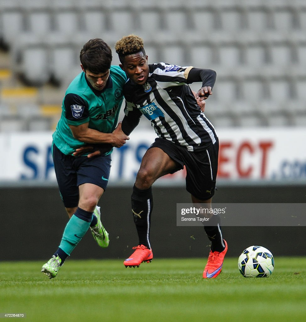 Rolando Aarons (R) of Newcastle jostle with Blackburn Rovers Jack Doyle (L) for the ball during the Under 21 Premier League match between Newcastle United and Blackburn Rovers at St. James' Park on May 5, 2015, in Newcastle upon Tyne, England, United Kingdom.
