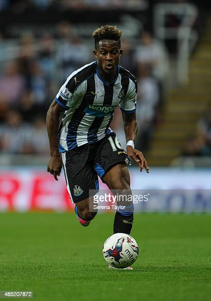 Rolando Aarons of Newcastle runs with the ball during The Capital One Cup second round match between Newcastle United and Northampton Town at StJames...