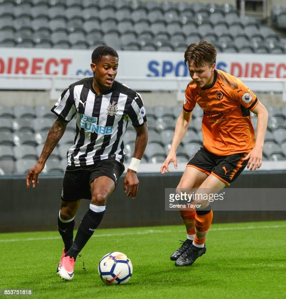 Rolando Aarons of Newcastle United is challenged during the Premier League 2 match between Newcastle United and Wolverhampton Wanderers at StJames'...