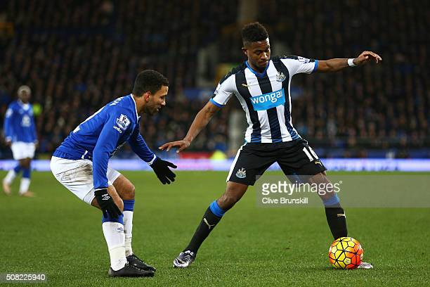 Rolando Aarons of Newcastle United is closed down by Aaron Lennon of Everton during the Barclays Premier League match between Everton and Newcastle...