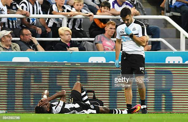 Rolando Aarons of Newcastle United lies on the ground injured during the EFL Cup second round match between Newcastle United and Cheltenham Town at...