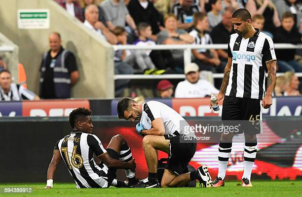 Rolando Aarons of Newcastle United receives treatment for an injury during the EFL Cup second round match between Newcastle United and Cheltenham...