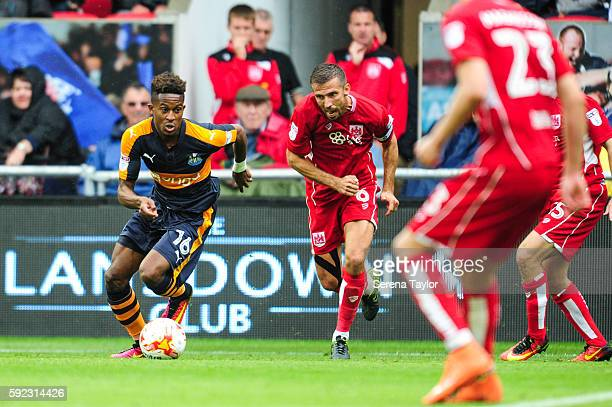 Rolando Aarons of Newcastle United runs with the ball whilst Gary O'Neil of Bristol City during the Sky Bet Championship Match between Bristol City...