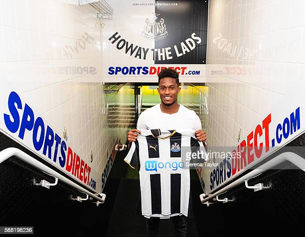 Rolando Aarons poses for photographs in the tunnel holding a club home shirt after signing a new 5 year contract for Newcastle United at StJames Park...