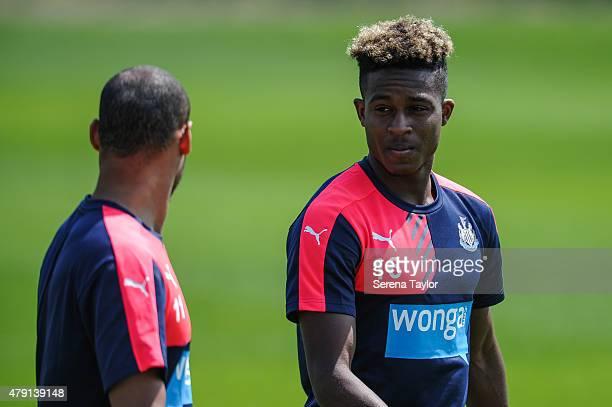 Rolando Aarons talks to Yoan Gouffran during the Newcastle United PreSeason Training session at The Newcastle United Training Centre on July 1 in...