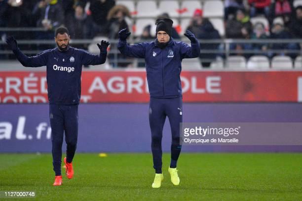 Rolando and Lucas Ocampos of Olympique de Marseille warmup before the Ligue 1 match between Olympique de Marseille and Stade de Reims at Stade...