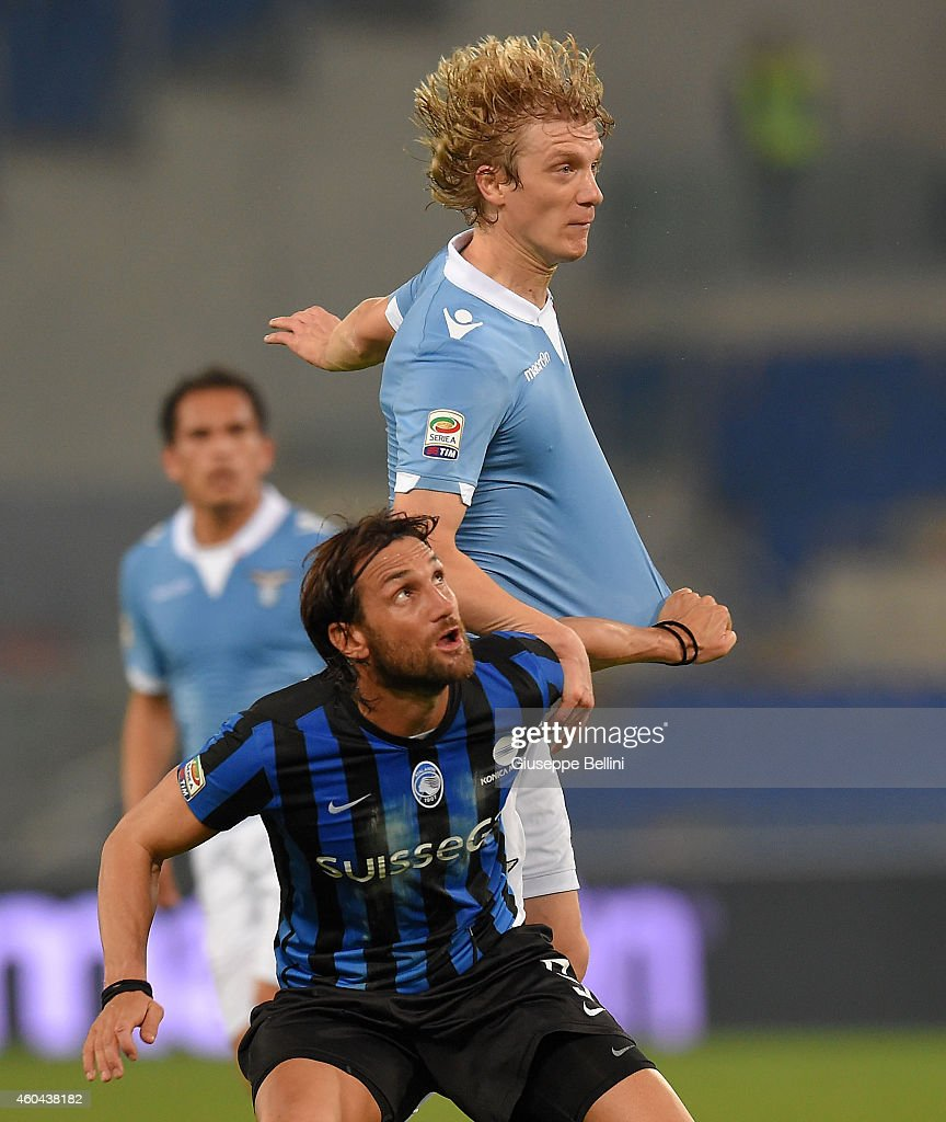 Rolando Bianchi of Atalanta BC and Dusan Basta of SS Lazio in action during the Serie A match between SS Lazio and Atalanta BC at Stadio Olimpico on December 13, 2014 in Rome, Italy.