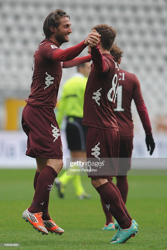 Rolando Bianchi (L) of Torino FC celebrates with team-mate Valter Birsa after scoring their second goal during the Serie A match between Torino FC and AC Siena at Stadio Olimpico di Torino on January 13, 2013 in Turin, Italy.
