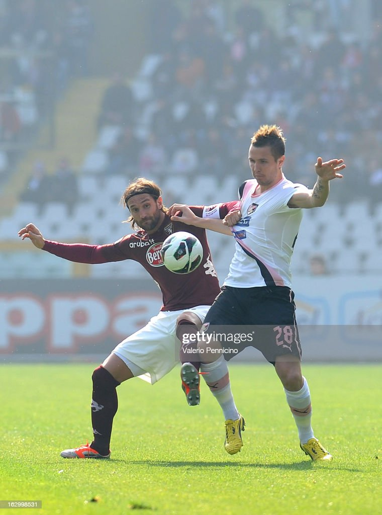 Rolando Bianchi (L) of Torino FC competes with Jasmin Kurtic of US Citta di Palermo during the Serie A match between Torino FC and US Citta di Palermo at Stadio Olimpico di Torino on March 3, 2013 in Turin, Italy.
