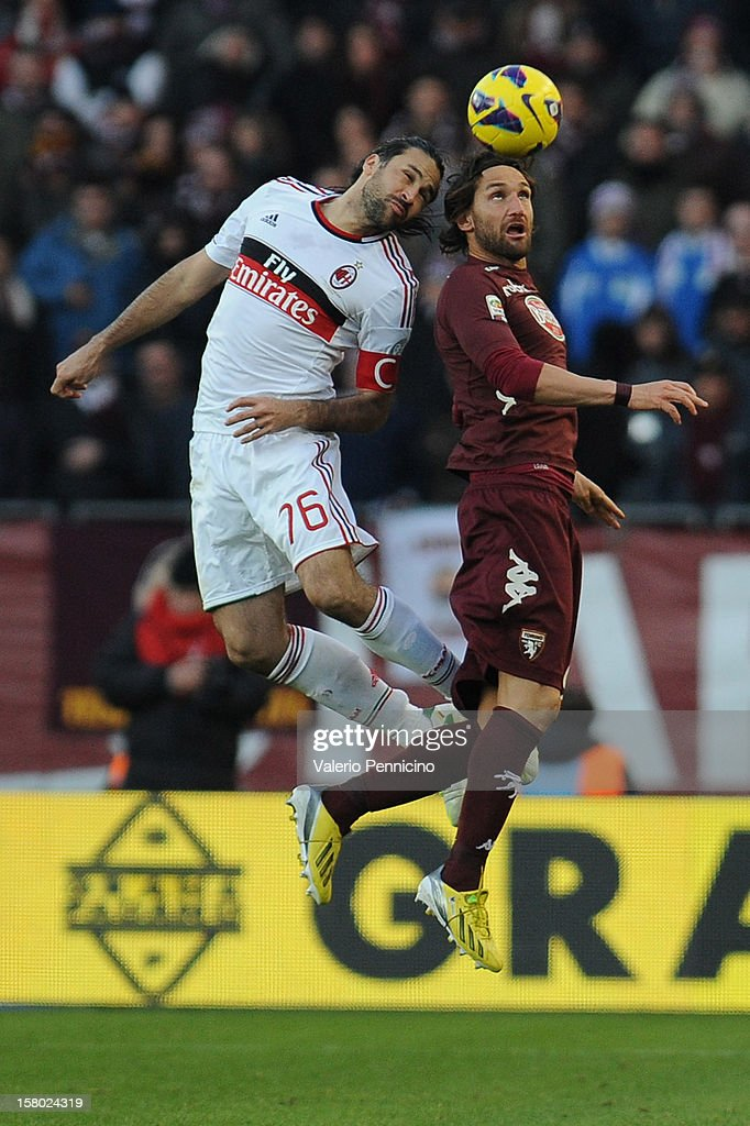 Rolando Bianchi (R) of Torino FC goes up with Mario Yepes of AC Milan during the Serie A match between Torino FC and AC Milan at Stadio Olimpico di Torino on December 9, 2012 in Turin, Italy.