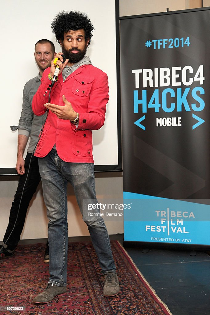 Rolando Brown (R) of Team Happy Here speaks at the Tribeca Hacks (Mobile) Presentation during the 2014 Tribeca Film Festival at Bennett Space on April 25, 2014 in New York City.