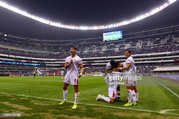 Rolando Cisneros of Chivas celebrates with teammate Alan Pulido after scoring the first goal of his team during the 2nd round match between Cruz Azul...