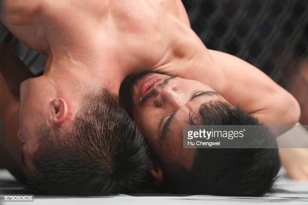 Rolando Dy of Phillippines fights with Wuliji Buren during the UFC Fight Night at MercedesBenz Arena on November 25 2017 in Shanghai China