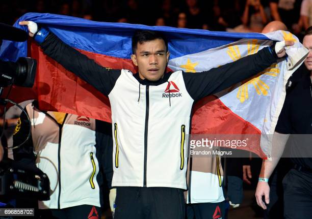 Rolando Dy of the Philippines prepares to enter the Octagon prior to his featherweight bout against Alex Caceres during the UFC Fight Night event at...