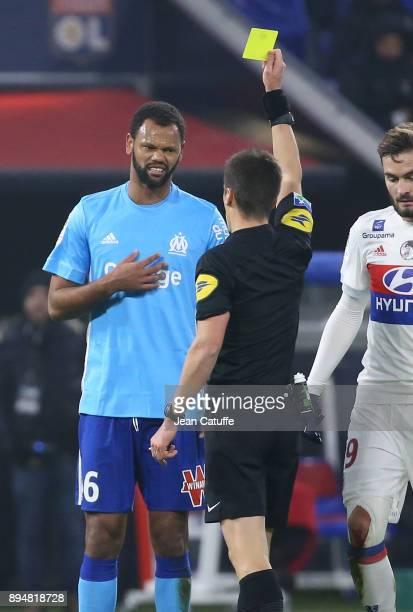 Rolando Fonseca of OM receives a yellow card from referee Benoit Bastien during the French Ligue 1 match between Olympique Lyonnais and Olympique de...
