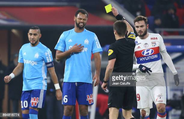 Rolando Fonseca of OM receives a yellow card from referee Benoit Bastien while Dimitri Payet of OM and Lucas Tousart of Lyon look on during the...