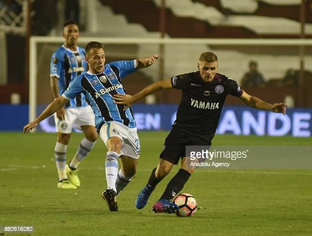 Rolando García Guerreno of Lanus in action against Arthur Henrique Ramos of Gremio during Copa Libertadores final match between Lanus and Gremio at...