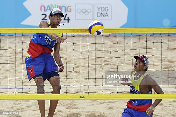 Rolando Hernandez and Jose Gregorio Gomez of Venezuela in action during their semi final match against Argentina during the Nanjing 2014 Youth...