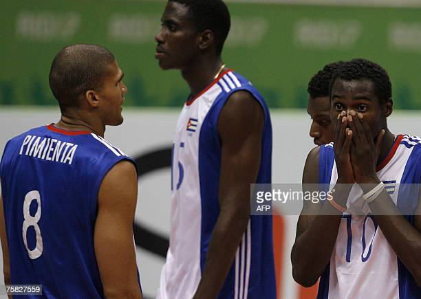 Rolando Jurquin Yoandry Diaz Oriol Camejo and Pavel Pimienta show their disappointment after losing the volleyball semifinal match to the United...