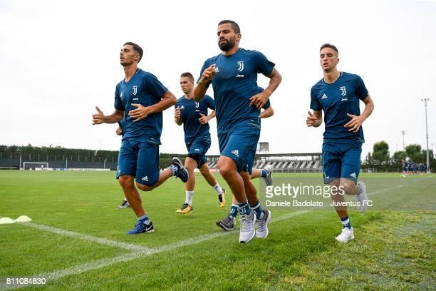 Rolando Mandragora Marko Pjaca Tomas Rincon Rodrigo Bentancur of Juventus during a training session on July 9 2017 in Vinovo Italy