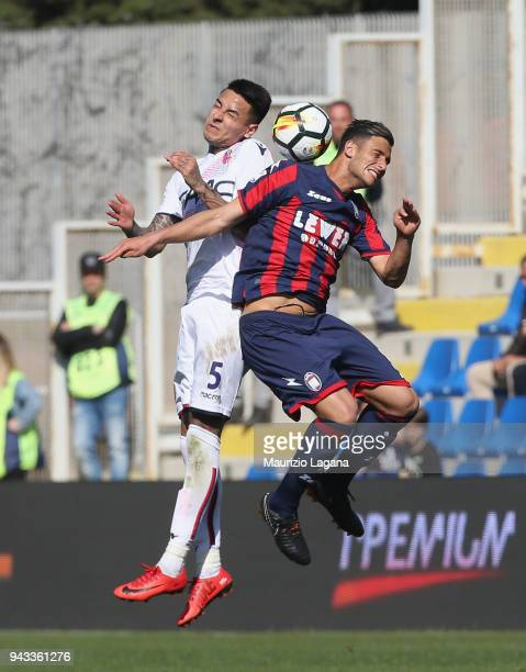 Rolando Mandragora of Crotone competes for the ball with Erick Pulgar of Bologna during the serie A match between FC Crotone and Bologna FC at Stadio...