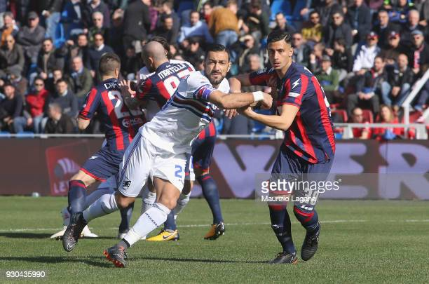 Rolando Mandragora of Crotone competes for the ball with Fabio Quagliarella of Sampdoria during the serie A match between FC Crotone and UC Sampdoria...