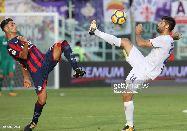 Rolando Mandragora of Crotone competes for the ball with Marco Benassi of Fiorentina during the Serie A match between FC Crotone and ACF Fiorentina...