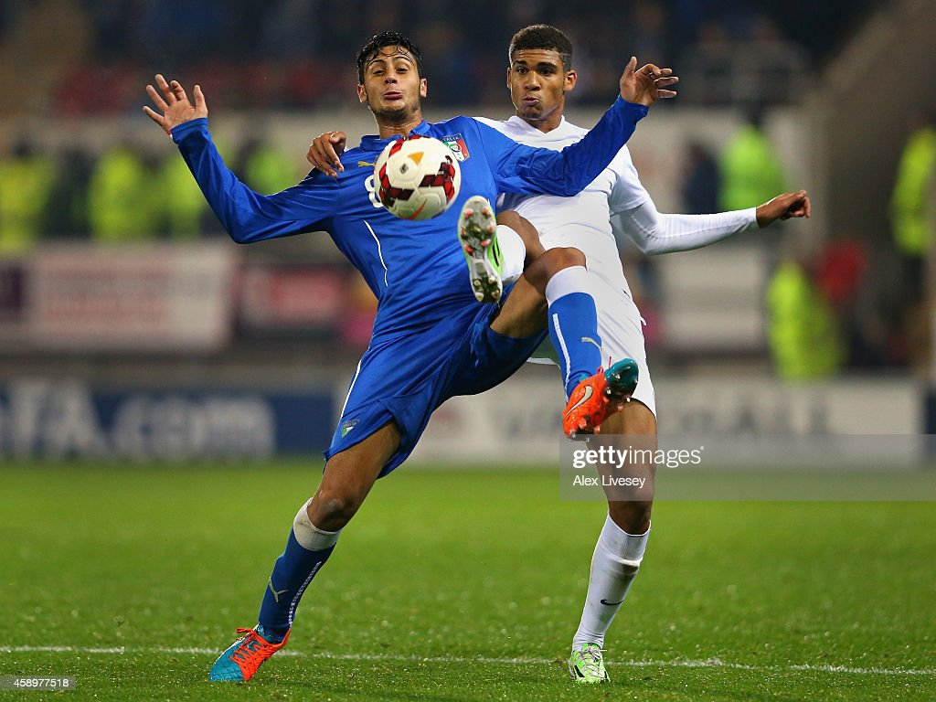 Rolando Mandragora of Italy U19 holds off a challenge from Ruben Loftus-Cheek of England U19 during the International friendly match between England U19 and Italy U19 at The New York Stadium on November 14, 2014 in Rotherham, England.