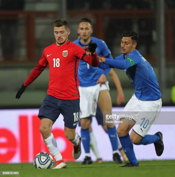 Rolando Mandragora of Italy U21 competes for the ball with Vebjorn Hoff of Norway during the international friendly match between Italy U21 and...
