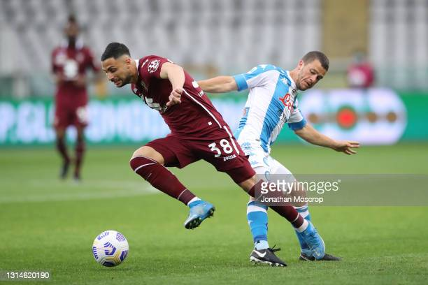 Rolando Mandragora of Torino FC hurdles a challenge from Diego Demme of SSC Napoli during the Serie A match between Torino FC and SSC Napoli at...