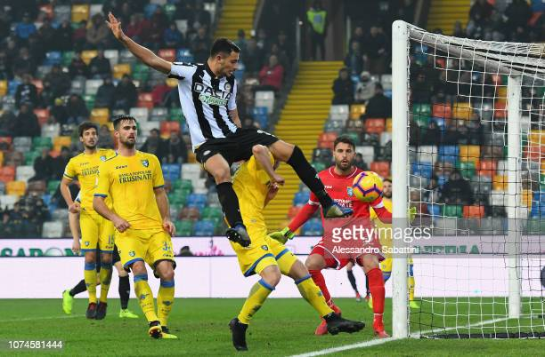 Rolando Mandragora of Udinese Calcio jump for the ball during the Serie A match between Udinese and Frosinone Calcio at Stadio Friuli on December 22...