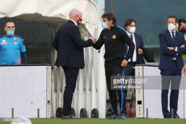 Rolando Maran Head coach of Genoa CFC fist pumps Antonio Conte Head coach of Internazionaleduring the Serie A match between Genoa CFC and FC...