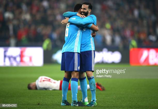Rolando of Marseille and Adil Rami of Marseille celebrate after winning the UEFA Europa Semi Final Second leg match between FC Red Bull Salzburg and...