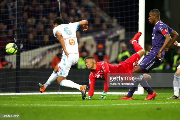 Rolando of Marseille and Alban Lafont of Toulouse during the Ligue 1 match between Toulouse and Olympique Marseille at Stadium Municipal on March 11...