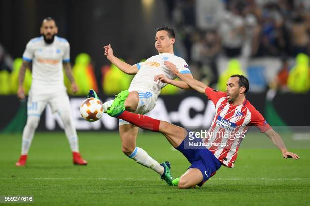 Rolando of Marseille holds off the challenge of Diego Godin of Atletico Madrid during the UEFA Europa League Final between Olympique de Marseille and...