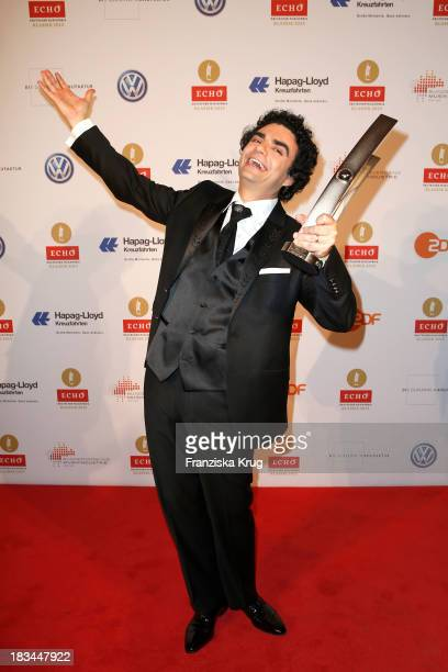 Rolando Villazon receives an award for the best solo performance singing an aria at the 'Echo Klassik Awards 2013' at Konzerthaus Berlin on October...