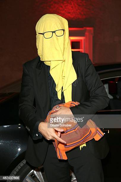 Rolando Villazon with a yellow scarf wraped over his face attends the 40 year stage anniversary of Placido Domingo during the Salzburg Festival on...